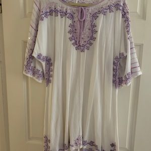 White linen dress with purple embroidery